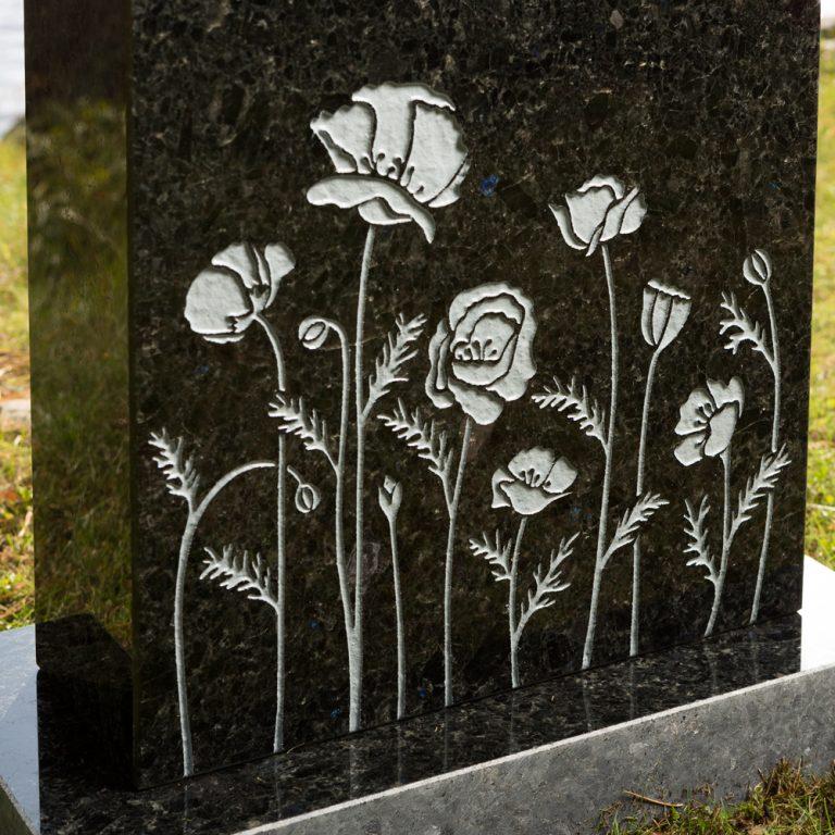 Kivilähde, hautakivet, kukat
